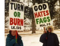 People holding hate filled signs against gays